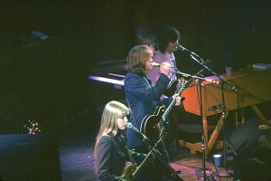 Playing with Mick Taylor and Carla Olson at the Roxy in LA 1990; that's the headstock of my bass in the lower left. Don't expect to get in many photos if you are playing with a rock star, even an ex-rock star.