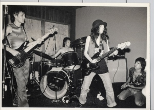 """The Skunks give Patti Smith (in hat) room to chant """"Have no fear! Tell God the Skunks are here!"""" as she rips the strings off Lois' guitar. That guitar was later stolen from our van in New York City, after our second night at CBGB."""
